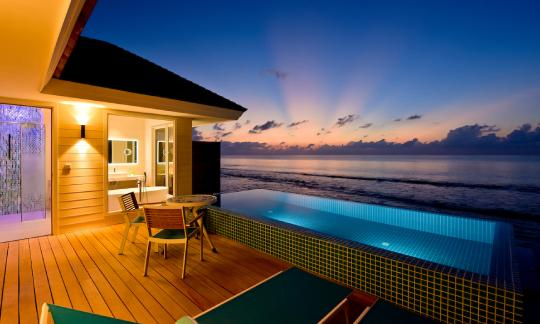 Ocean Pool Villa at dusk at Kandima Maldives